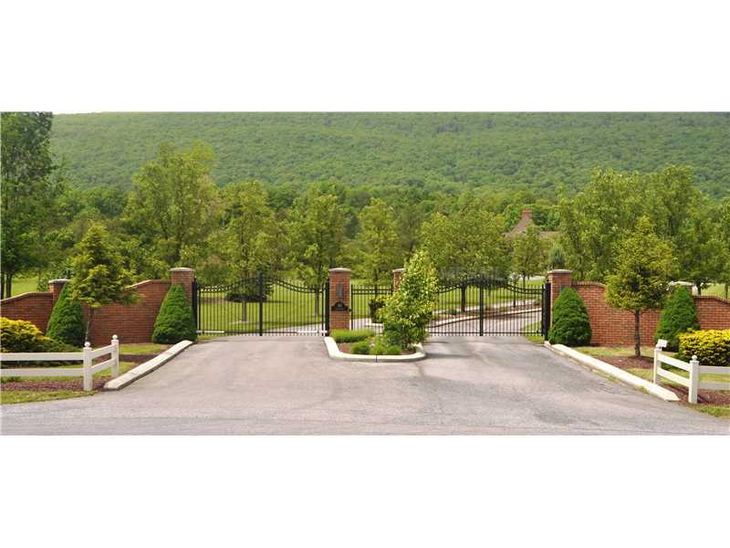 Exterior Front - A set of majestic gates will lead you to your p